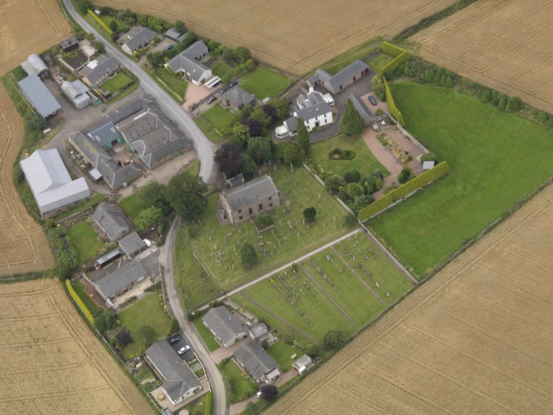 General oblique aerial view of Kirkton of Tealing centred on the church taken from the SSW.