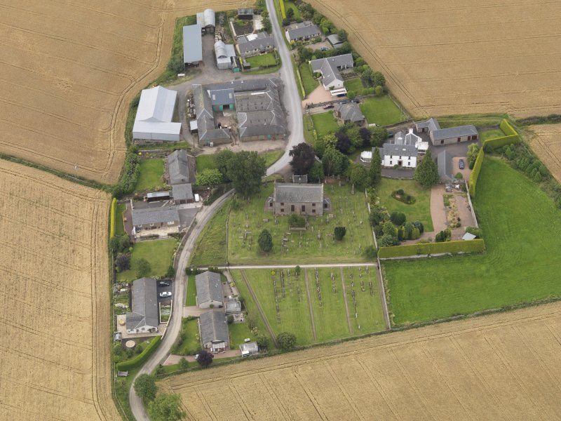 General oblique aerial view of Kirton of Tealing centred on the church taken from the S.