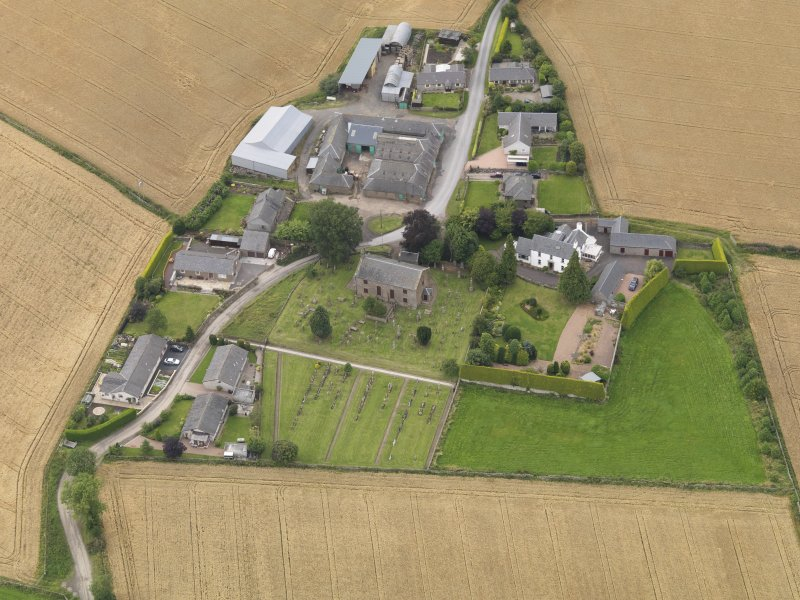 General oblique aerial view of Kirton of Tealing centred on the church taken from the SSE.