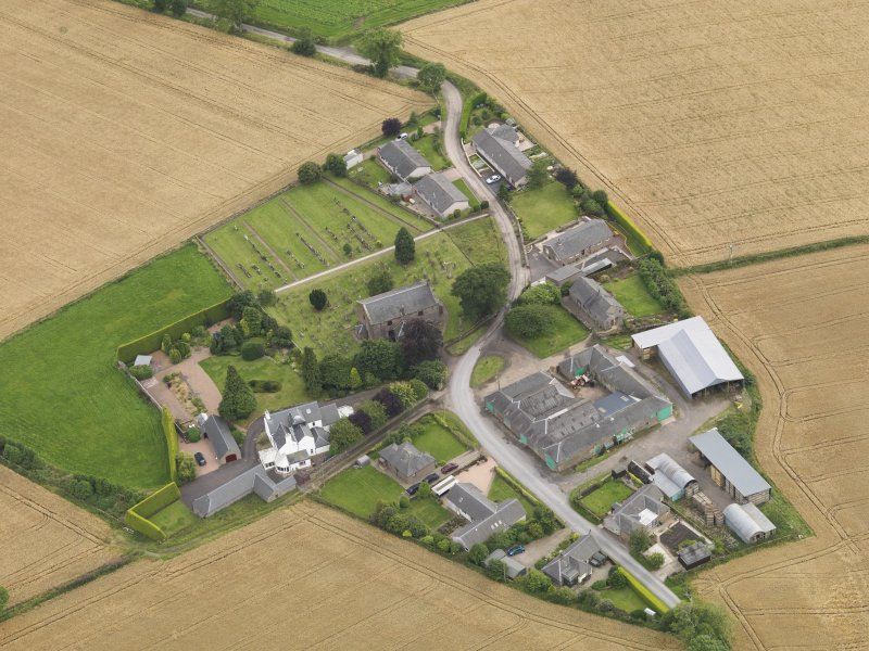 General oblique aerial view of Kirton of Tealing centred on the church taken from the NNE.