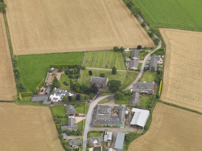 General oblique aerial view of Kirton of Tealing centred on the church, taken from the N.