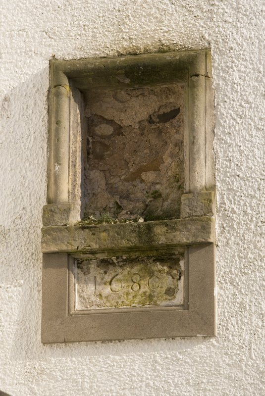 Detail of niche and datestone (1680) on W wall of E range