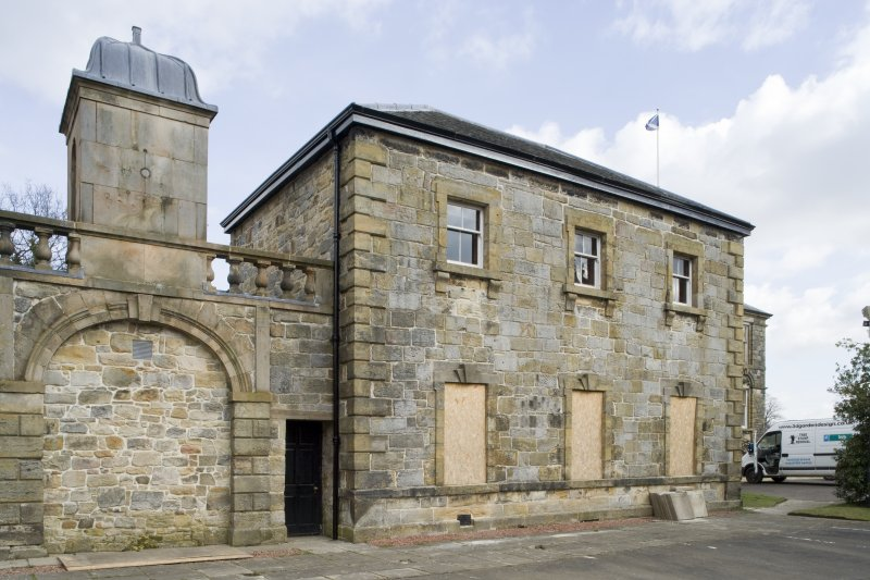 View of the East Pavilion at Cumbernauld House, taken from the West-South-West. The photograph also shows the blocked archway and cupola above the two pavilions.