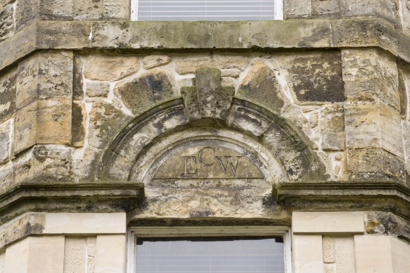 Detail from the North-East elevation of Cumbernauld House, showing the carved stone at first floor level of the central projecting bay.