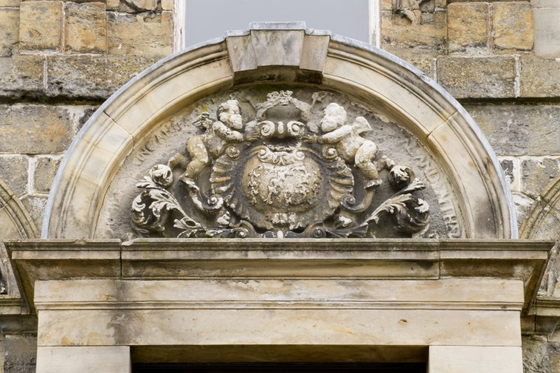 Detail of the arched pediment above the main entrance door of the South-West (principle) elevation of Cumbernauld House, Cumbernauld.