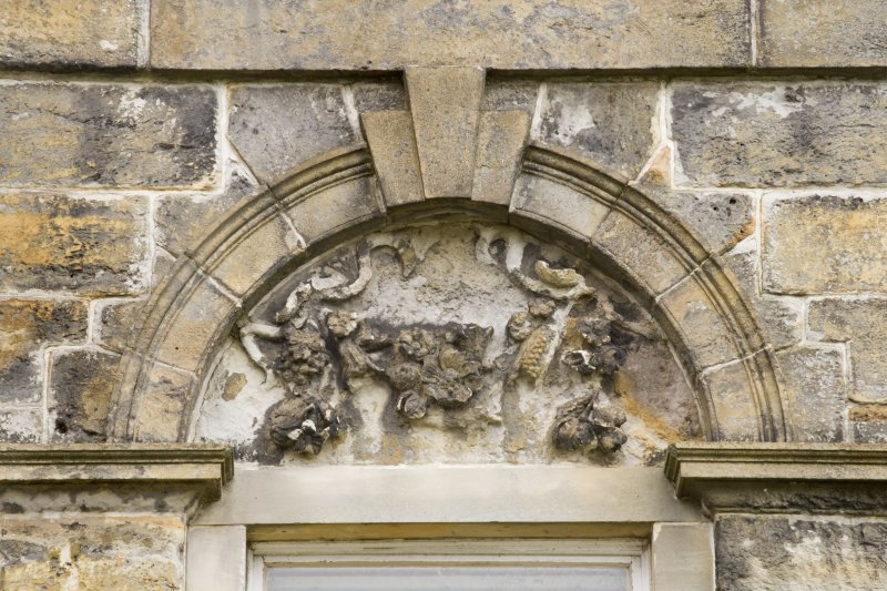 Detail of the arched pediment over first floor window of the South-West (principle) elevation of Cumbernauld House, Cumbernauld.