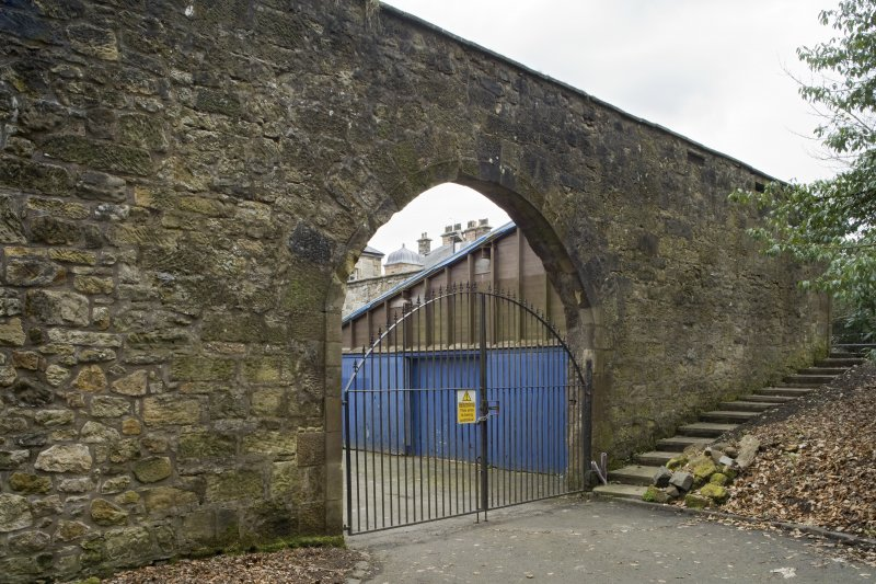 View of the South wall and arched entrance of the Courtyard at Cumbernauld House, Cumbernauld, taken from the West.