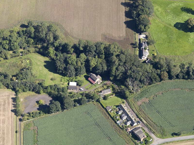 General oblique aerial view of Woodside Cottages, centred on the mill, taken from the SW.