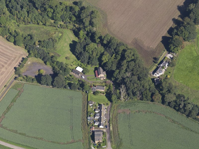 General oblique aerial view of Woodside Cottages, centred on the mill, taken from the SSW.