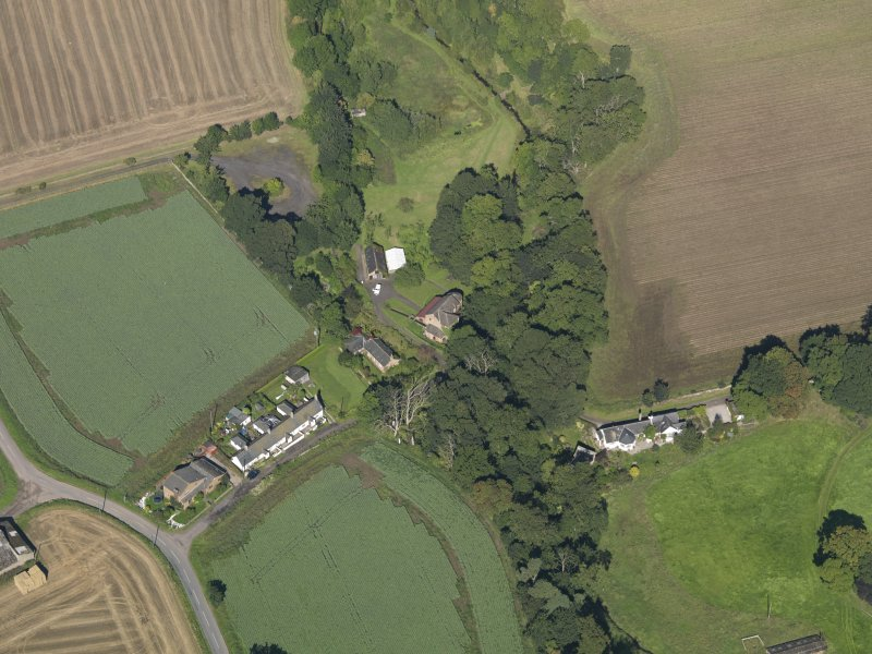 General oblique aerial view of Woodside Cottages, centred on the mill taken from the SE.