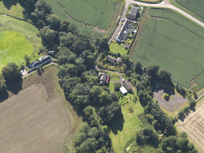 General oblique aerial view of Woodside Cottages, centred on the mill, taken from the NW.