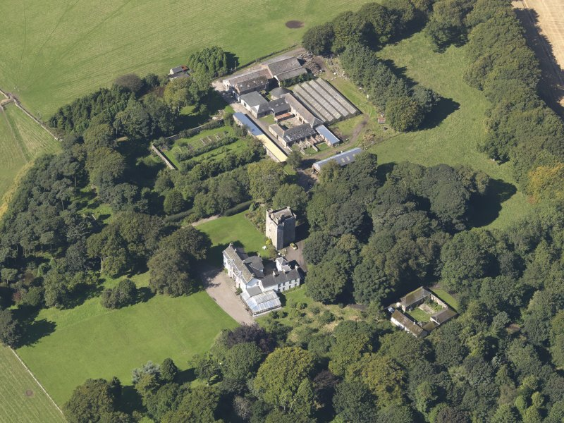 General oblique aerial view of the Affleck Estate, centred on the castle, taken from the SE.