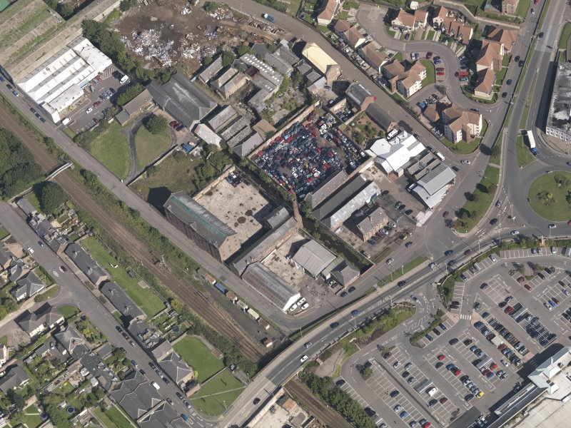 General oblique aerial view of the industrial area centred on Greens Mills, taken from the SW.