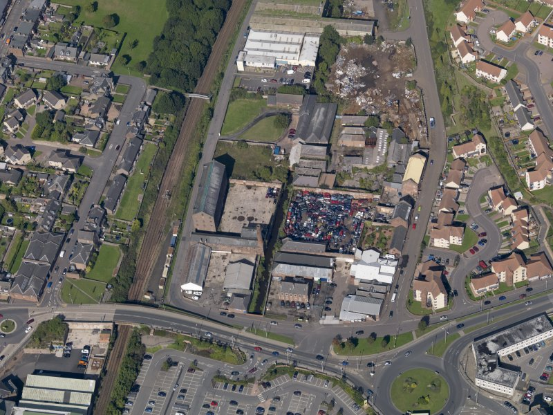 General oblique aerial view of the industrial area centred on Greens Mills, taken from the S.