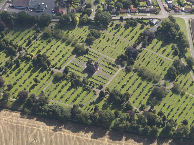 General oblique aerial view of the Western Cemetery, centred on the mortuary chapel, taken from the NW.