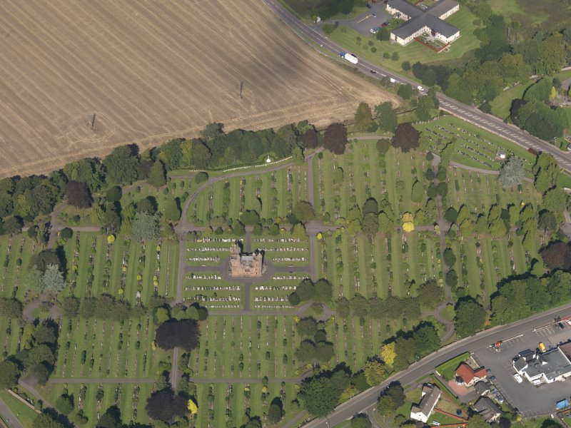 General oblique aerial view of the Western Cemetery, centred on the mortuary chapel taken from the S.