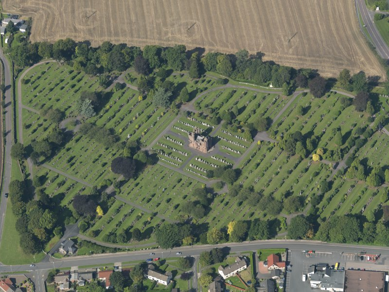 General oblique aerial view of the Western Cemetary, Arbroath, centred on the mortuary chapel, taken from the SE.