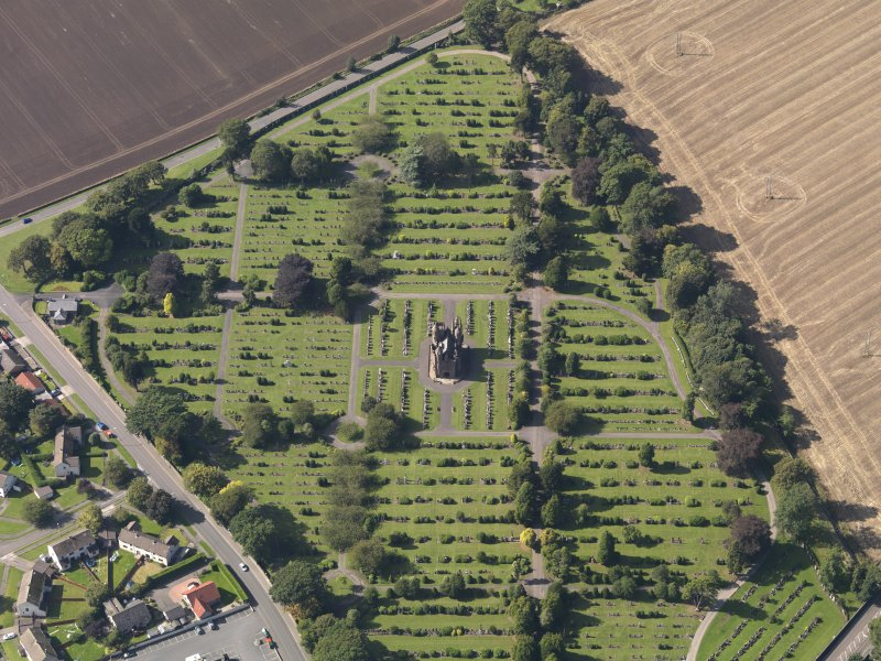 General oblique aerial view of the Western Cemetery, centred on the mortuary chapel, taken from the ENE.