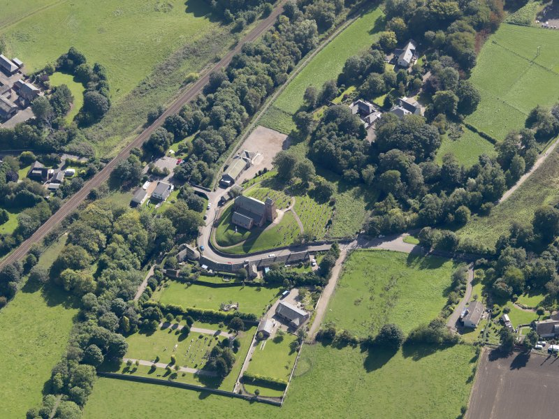 General oblique aerial view of St Vigeans, centred on the church, taken from the NW.