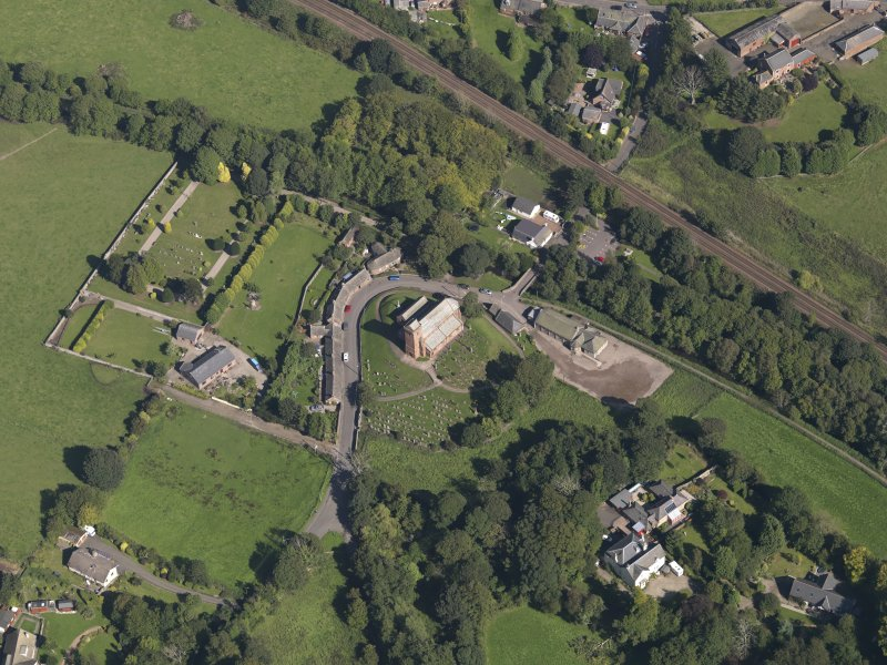 General oblique aerial view of St Vigeans, centred on the church, taken from the SW.