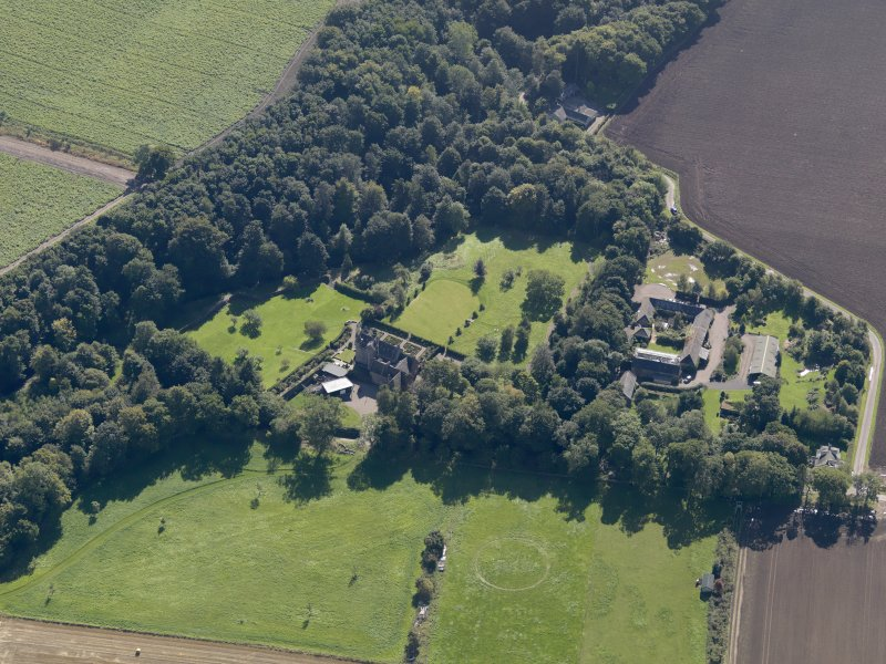 General oblique aerial view of the Gardyne Estate, centred on  Gardyne Castle, taken from the N.