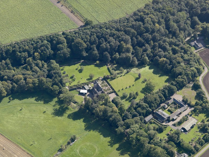 General oblique aerial view of the Gardyne Estate, centred on  Gardyne Castle, taken from the NW.