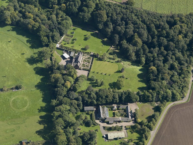 General oblique aerial view of the Gardyne Estate, centred on  Gardyne Castle, taken from the W.