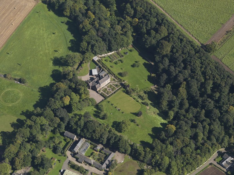 General oblique aerial view of the Gardyne Estate, centred on  Gardyne Castle, taken from the WSW.