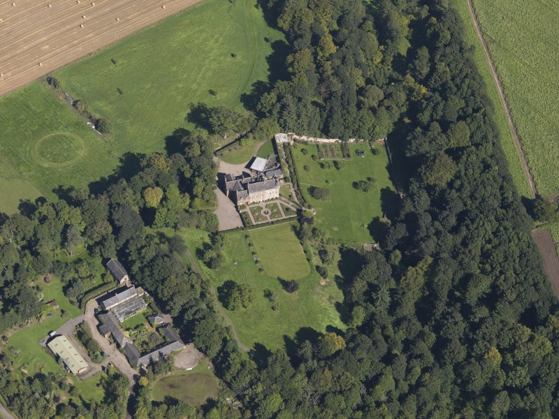 General oblique aerial view of the Gardyne Estate, centred on  Gardyne Castle, taken from the SSW.