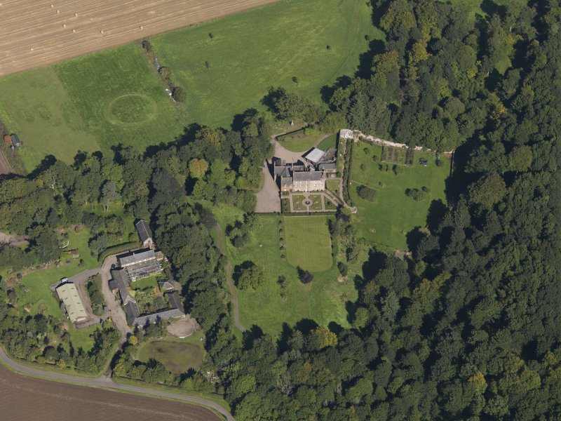 General oblique aerial view of the Gardyne Estate, centred on  Gardyne Castle, taken from the S.