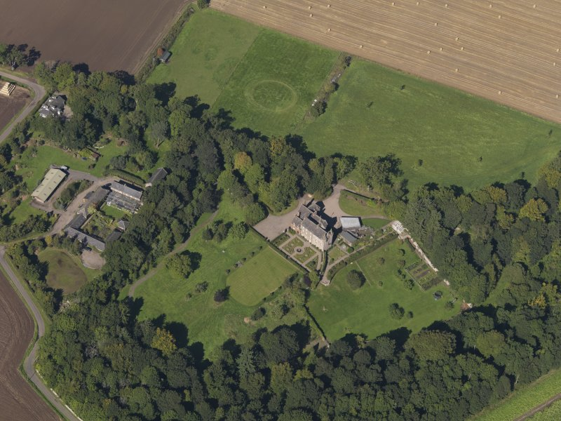 General oblique aerial view of the Gardyne Estate, centred on  Gardyne Castle, taken from the SSE.