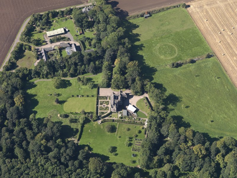 General oblique aerial view of the Gardyne Estate, centred on  Gardyne Castle, taken from the E.