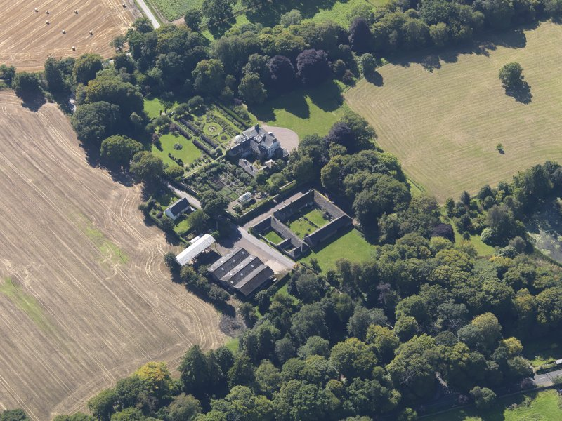 General oblique aerial view of the Pitmuies Estate, centred on  Pitmuies House, taken from the NE.