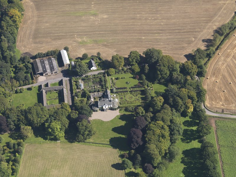 General oblique aerial view of the Pitmuies Estate, centred on  Pitmuies House, taken from the WSW.