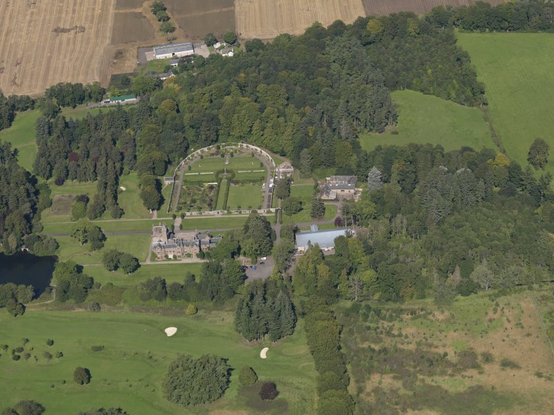General oblique aerial view of the Guthrie Estate, centred on  Guthrie Castle, taken from the S.