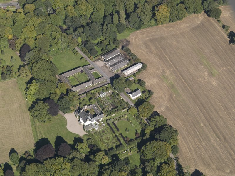 General oblique aerial view of the Pitmuies Estate, centred on  Pitmuies House, taken from the S.