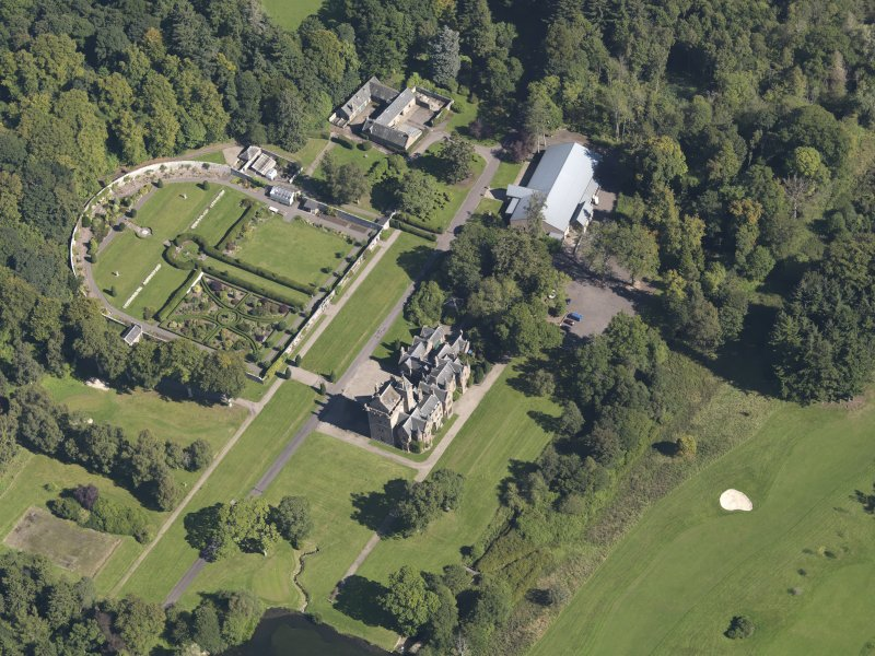 General oblique aerial view of the Guthrie Estate, centred on  Guthrie Castle, taken from the SW.