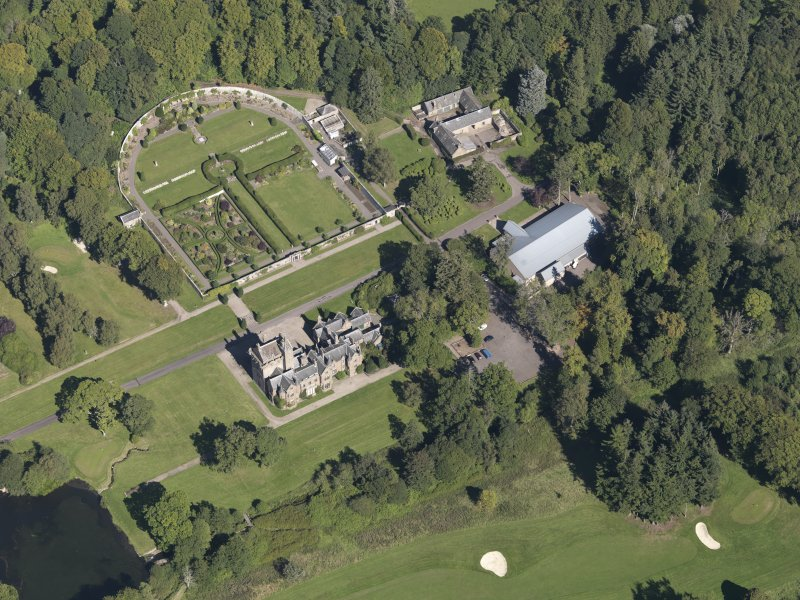 General oblique aerial view of the Guthrie Estate, centred on  Guthrie Castle, taken from the SSW.
