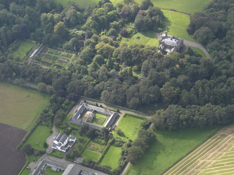 General oblique aerial view of the Dunninald estate, centred on Dunninald Mains Farmhouse,  taken from the ENE.