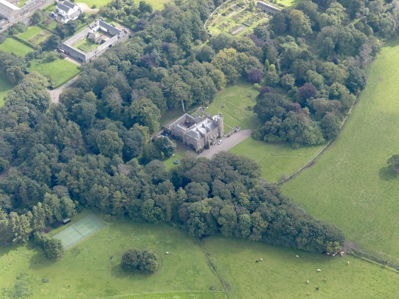 General oblique aerial view of the Dunninald estate, centred on Dunninald Castle, taken from the NW.