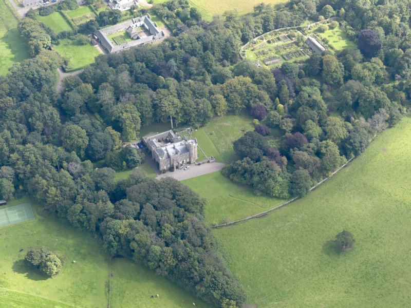 General oblique aerial view of the Dunninald estate, centred on Dunninald Castle, taken from the WNW.