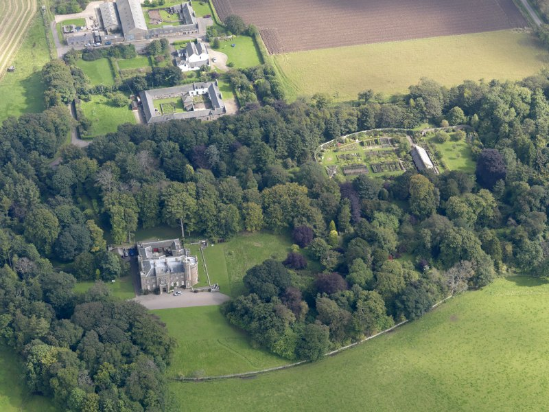 General oblique aerial view of the Dunninald estate, centred on Dunninald Castle, taken from the W.