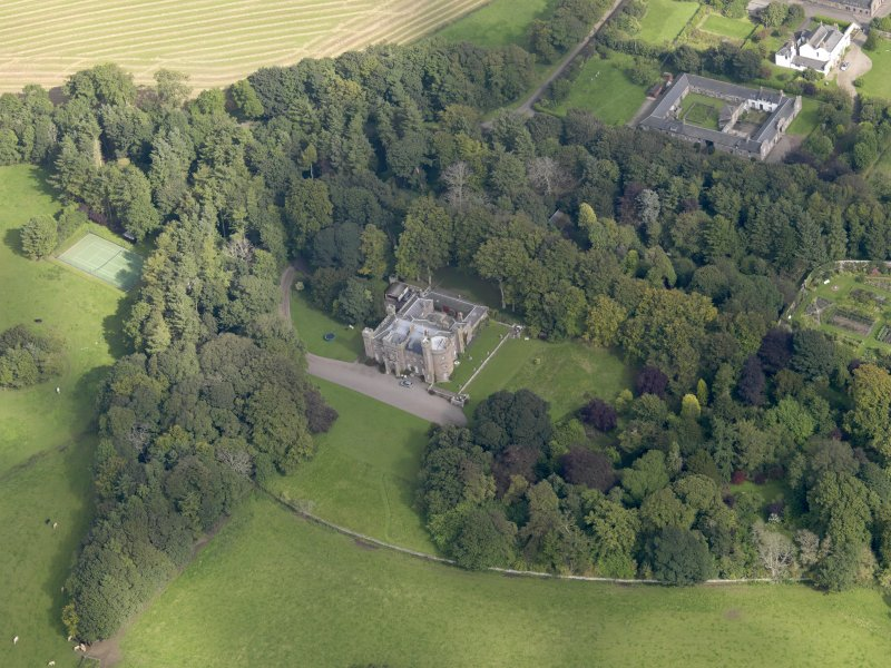General oblique aerial view of the Dunninald estate, centred on Dunninald Castle, taken from the SSW.