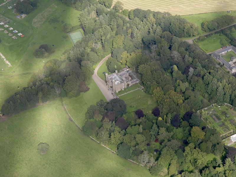 General oblique aerial view of the Dunninald estate, centred on Dunninald Castle, taken from the S.