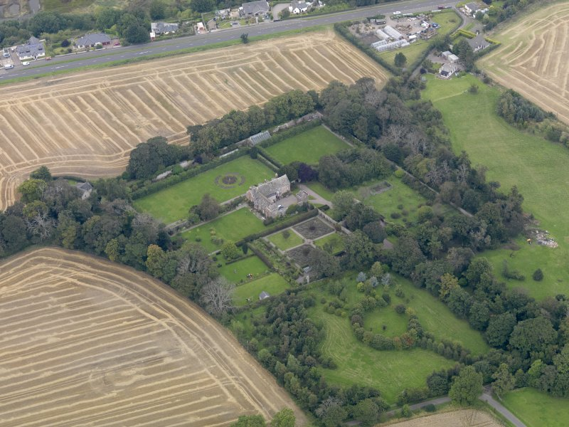 General oblique aerial view of the Usan estate, centred on Usan House, taken from the SSW.