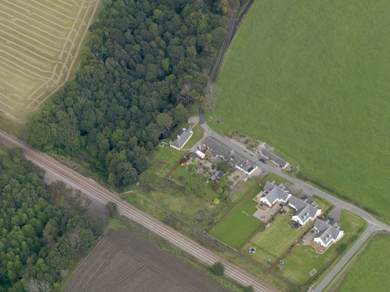 General oblique aerial view of the village of Logie, centred on Logie Church, taken from the SSW.