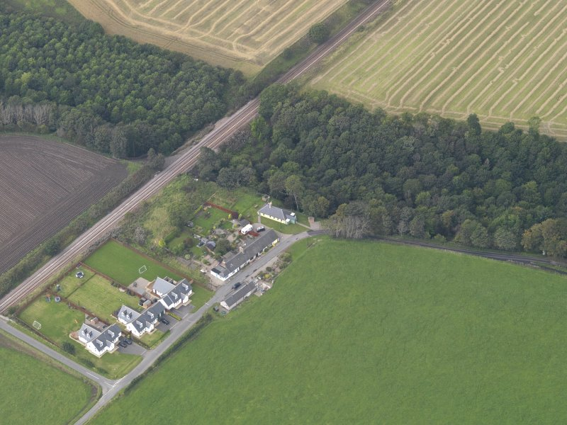 General oblique aerial view of the village of Logie, centred on Logie Church, taken from the E.