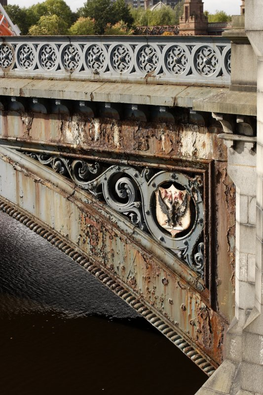 Detail of wrought ironwork with shield on N arch