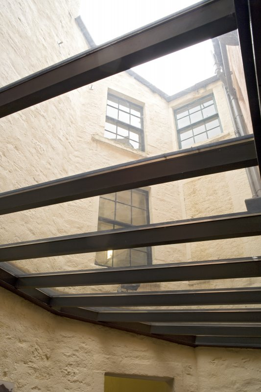 Interior.  Ground floor.  Reception area, view through glazed roof showing rear courtyard.