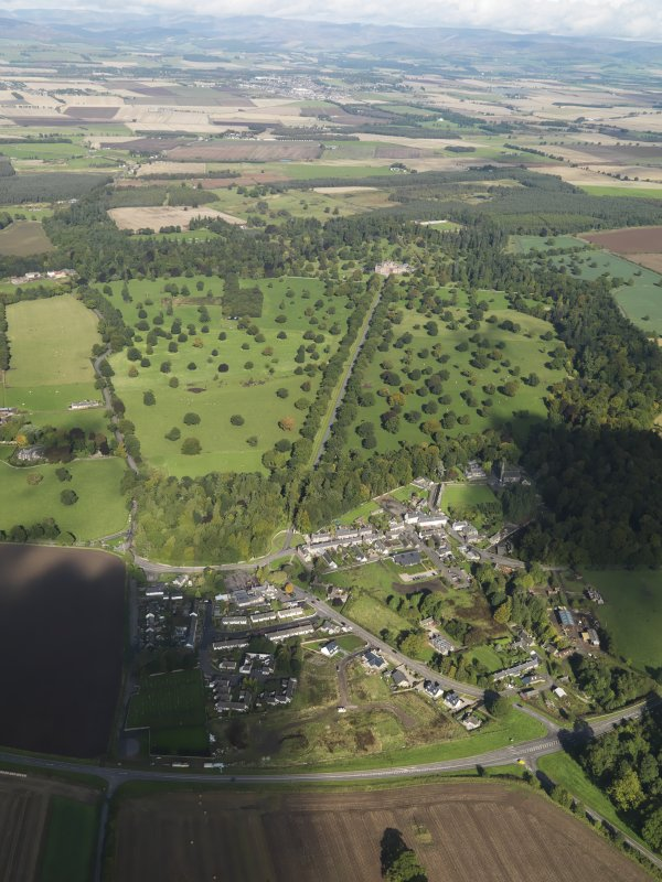 General oblique aerial view of Glamis Castle and its Policies with Glamis Village in the immediate foreground taken from the S.
